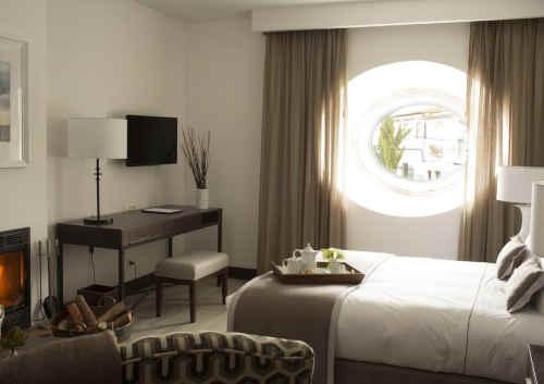 Pateo dos Solares Charm Hotel - Quarto com lareira
